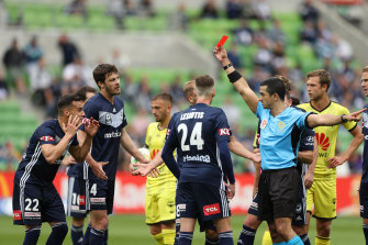 Kristian Dobras is shown the red card.