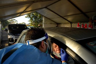 Laverty Pathology staff conducting COVID-19 tests at the Roselands drive through testing clinic, earlier this month.