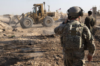 The US Army supervises the removal of military fortifications on the border of Turkey and Syria in August.