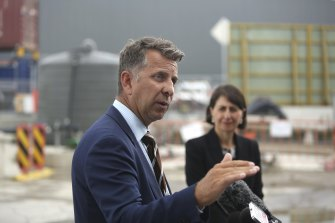 Transport Minister Andrew Constance, pictured with Premier Gladys Berejiklian, says NSW should subsidise the entry of electric vehicles into the NSW market.