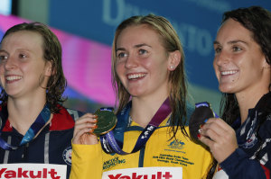 Australian gold medallist Ariarne Titmus, centre, stands with silver medallist United States' Katie Ledecky and her compatriot and bronze medallist Leah Smith after the 400m freestyle final at the World Swimming Championships in Gwangju.