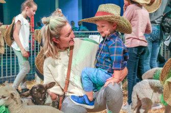 Kellie Hardman and her son Tom Hardman, 3, in the animal pen.