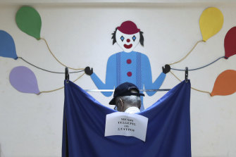 A man casts his ballot at a polling station in Athens, on Sunday.