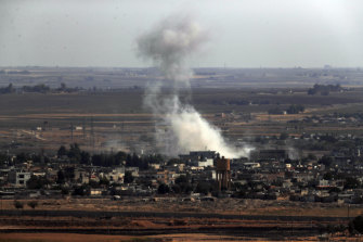 Smoke and dust billows from targets in Ras al-Ayn, Syria, caused by bombardment by Turkish forces.