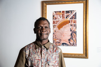 Winner of the Telstra Emerging Artist Award Titus Nganjmirra, with his portrait of the queen.