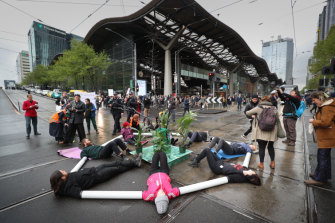 Protesters locked themselves together using plastic pipes.