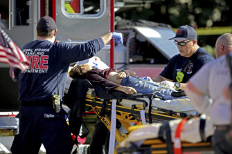 Medical personnel tend to a victim following a shooting at Marjory Stoneman Douglas High School in Parkland, Florida, in February last year.