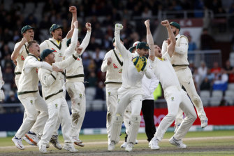 How sweet it is: Australia celebrate retaining the Ashes at Old Trafford.