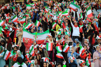 Women fans were restricted to one area of the stadium at the Iran-Cambodia match.