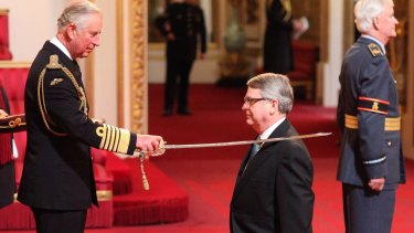 The Prince of Wales makes Lynton Crosby a Knight Bachelor of the British Empire at Buckingham Palace in May, 2016.