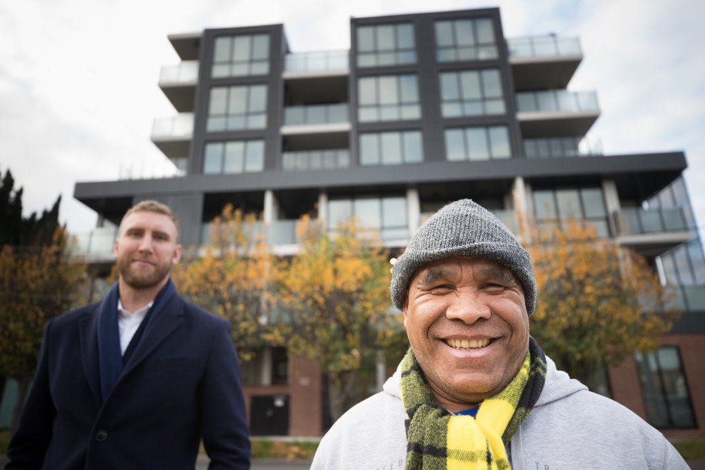 Armindo De Olizeara (right) outside his new home at a social housing development in Footscray, with Unison acting CEO James King.CREDIT:JASON SOUTH