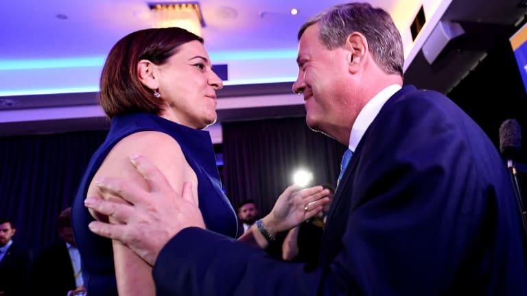 Mr Nicholls hugs Deputy Leader Deb Frecklington (left) on the night of election.