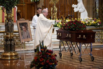 Father Brian Lucas blesses John Brennan's coffin during his funeral at St Mary's Cathedral on Wednesday.