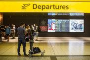 21.12.18 The Age Generic Tullamarine. Passengers queue past the departures sign at Melbourne Airport. Photo: Scott McNaughton