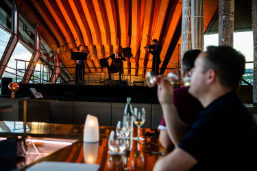 The SSO performing to diners at Bennelong Restaurant, Sydney Opera House.
