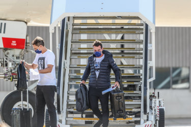 Tennis players and officials arriving in Melbourne on Thursday ahead of the Australian Open.