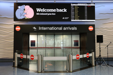 Signs welcome travelers back to New Zealand at Auckland International Airport.