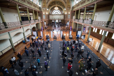 People wait to be vaccinated at Melbourne's Royal Exhibition Building.