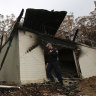 Three charged as police patrol fire-ravaged South Coast for looters