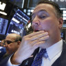 Wall Street closes at record high on rate cut hopes