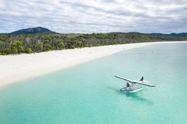 <p>Aerial of seaplane next to the beach</p>
