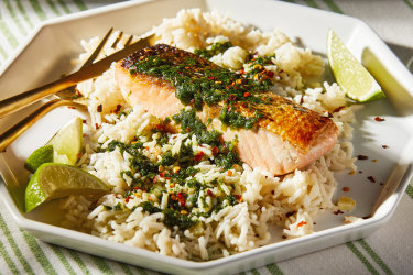 Coconut rice with salmon and coriander sauce.