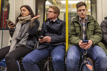 London, England - March 20, 2018: Four passengers in the famous London underground train iStock image for Traveller. Re-use permitted.