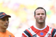 Gone: Boyd Cordner is escorted off the field against Canberra.