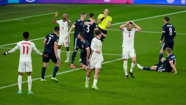England's Declan Rice (white shirt, right) reacts after missing a chance during the clash with Scotland.