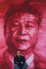 Adam Chang in front of his Xi Jinping painting.