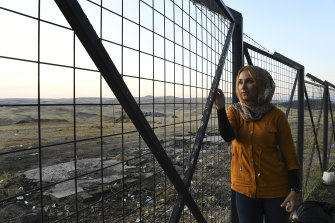 Amina Abdulkhaleq, 25, looks out at the Syria-Iraq border from the relative safety of an Iraqi receiving centre for refugees.