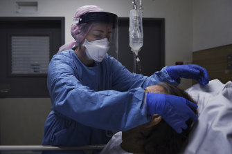 St Vincent's nurse Talyna Smith cares for a suspected COVID-19 patient in an isolation room.