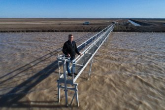 Ian Cole, a former owner of Darling Farms and now a member of irrigator groups, stands on a platform over one of the farm's storages near the NSW town of Bourke.
