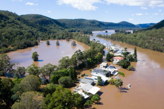 Drone footage above the flooded Macdonald River on Wednesday.