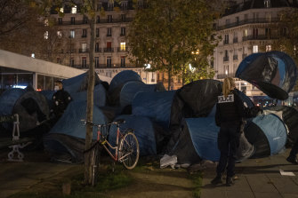 Paris police are under government orders to explain themselves after officers were filmed tossing migrants out of tents while evacuating them.
