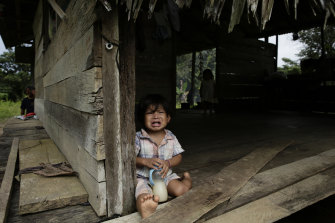 A boy from the Ngabe Bugle indigenous group at his home in the community of El Terron, Panama.