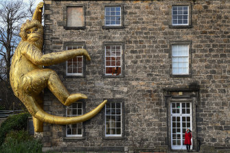 Lisa Roet's giant golden monkey on the side of Inverleith House in Edinburgh last month.