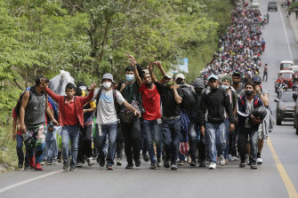 Migrants enter Guatemala after breaking a police barricade at the border checkpoint on January 16, 2021 in El Florido, Guatemala.