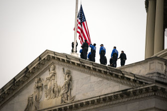 US Capitol Police lower the American flag at the US Capitol in Washingtonto mark the death of Capitol Police Officer Brian Sicknick.