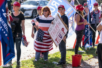 Trump supporters gather outside the Trump National Golf Club in Sterling, Virginia.