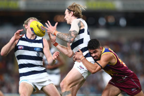 Brisbane Lion Charlie Cameron tackles Geelong's Tom Stewart at the Gabba on Thursday night.