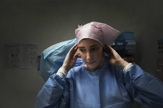 Nurse Talyna Smith prepares to enter an isolation room at St Vincent's Hospital.