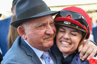 Trainer Leon Macdonald celebrates with jockey Raquel Clark after she rode Dalasan to victory.