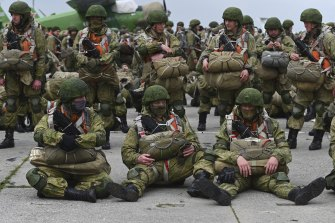Russian paratroopers wait to be loaded into a plane for airborne drills on Thursday.