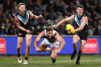Trent McKenzie and Darcy Byrne-Jones compete for the ball with Geelong's Tom Hawkins.