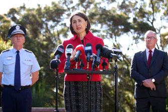 NSW Police Commissioner Mick Fuller with Premier Gladys Berejiklian and Health Minister Brad Hazzard on Monday.
