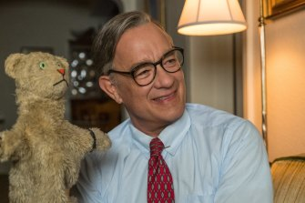 Watch that smile. Tom Hanks as the jovial Fred Rogers.