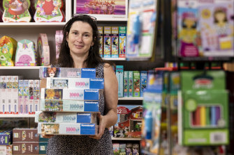 Clare Gordon, who is a shop assistant at Discount Toy Company, is being rushed off her feet with orders for puzzles and games.