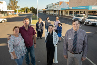 Biloela locals have rallied around the Murugappan family. They include (at front, left to right) Marie and Jeff Austin, Rita Twomey, Banana Shire Mayor Nev Ferrier, and (at back) Laraine Webster, Jayne Centurion, and Sarah and Eloise Broadley.