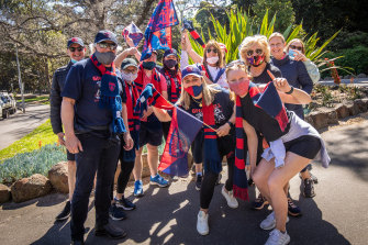 Demons fans out celebrating in South Yarra.